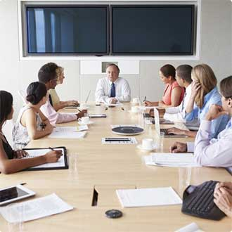 people sitting around meeting table