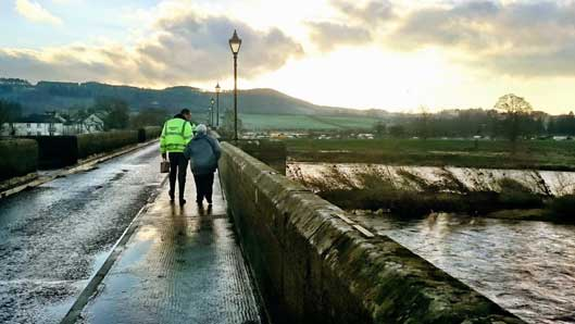 environment agency worker with elderly person