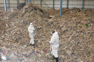 Workers at a waste disposal site