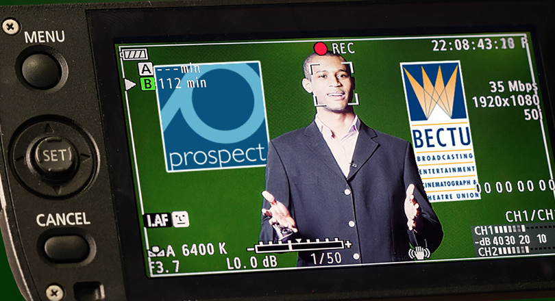 member stood in front of a camera with BECTU and Prospect Logos